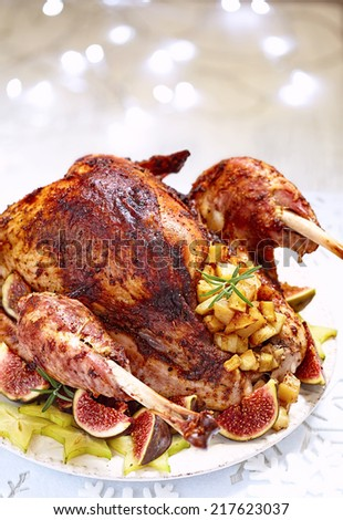 Roasted turkey with fruits for a holidays - stock photo