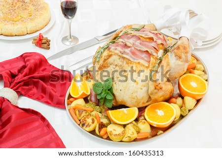 Roasted  turkey with turkey frills on festive table. Bacon and Herb Roasted Turkey on festive table.  - stock photo