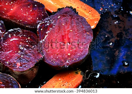 roasted vegetables beets carrots dark background selective focus toning rustic old style - stock photo