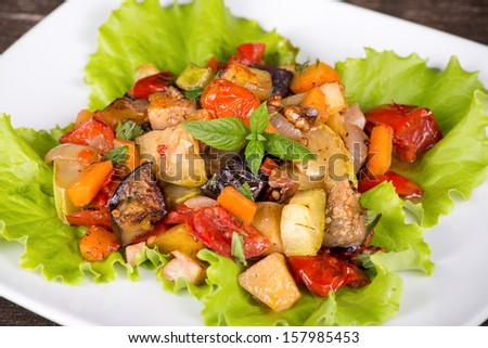 Roasted vegetables on a white plate, close up - stock photo