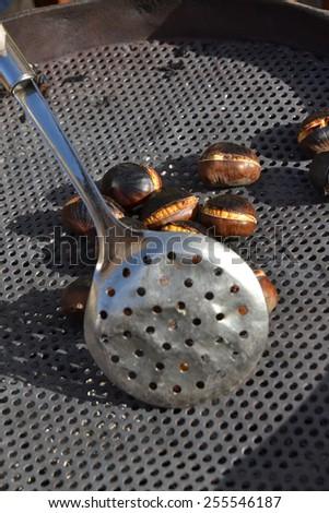 Roasting chesnuts. - stock photo