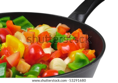 Roasting pan with the vegetables. Red and green peppers, onions, tomatoes. Isolated on white - stock photo