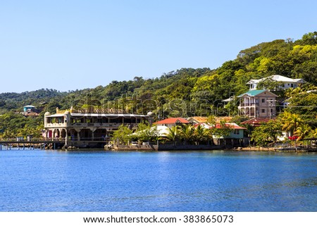 ROATAN ILAND HONDURAS JAN 28 2016: Coxen Hole, also called Roatan Town, is the largest city on the island of Roat�¡n, and the capital of the Bay Islands of Honduras, with a population of 5,070 - stock photo
