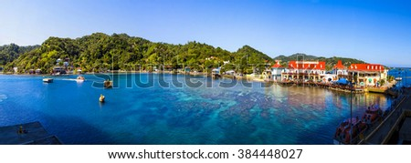 ROATAN ILAND HONDURAS JAN 28 2016: Coxen Hole, Roatan Town, is the capital of the Bay Islands of Honduras, with a population of 5,070, Favorite spot for cruise ships and tropical lover vacationers. - stock photo