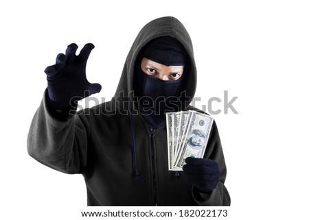 Robber holding money isolated on white background - stock photo