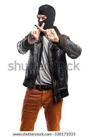 Robber making stop sign - stock photo