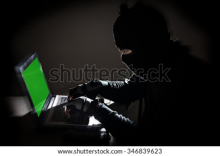 Robber man hacking computer - stock photo
