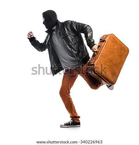 Robber running fast - stock photo