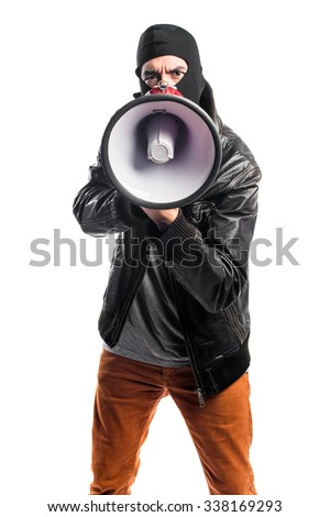 Robber shouting by megaphone - stock photo