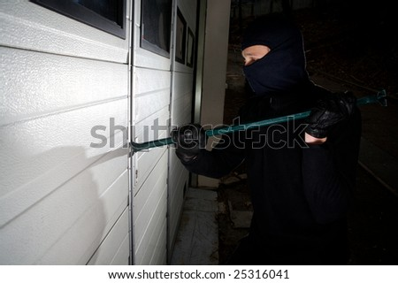 robber violation property commit a crime - stock photo