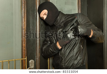robber with gun - stock photo
