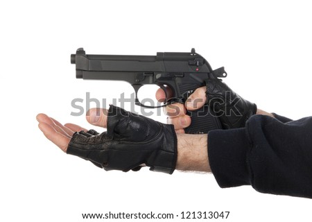 Robber with gun holding out hand against a white background - stock photo