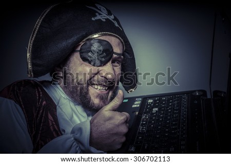 Robbery, computer security, hacker pirate dress with hat and skull - stock photo