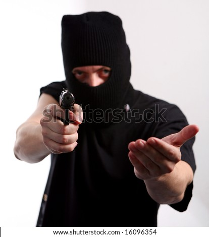 Robbery with gun and mask. - stock photo