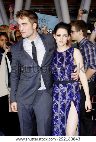 "Robert Pattinson and Kristen Stewart at the World Premiere of ""The Twilight Saga: Breaking Dawn Part 1"" held at Nokia Theatre L.A. Live in Los Angeles, California, United States on November 14, 2011. - stock photo"