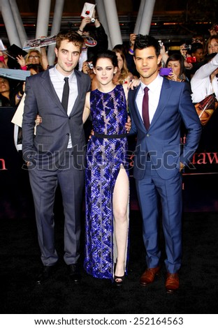 "Robert Pattinson, Kristen Stewart and Taylor Lautner at the Los Angeles Premiere of ""The Twilight Saga: Breaking Dawn Part 1"" held at the Nokia Theatre L.A. Live in Los Angeles on November 14, 2011. - stock photo"