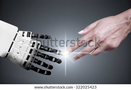 Robot and human touching forefingers  - stock photo
