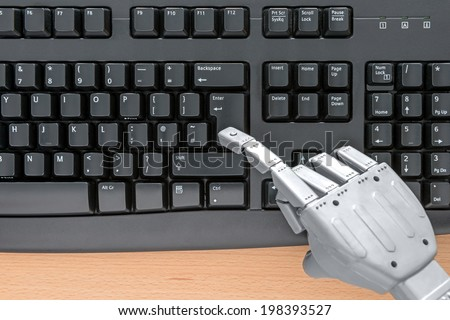 Robot hand typing on a computer keyboard. - stock photo