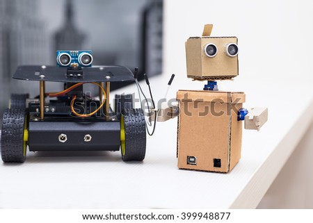 robot keeps wires and stands next to the other robot - stock photo