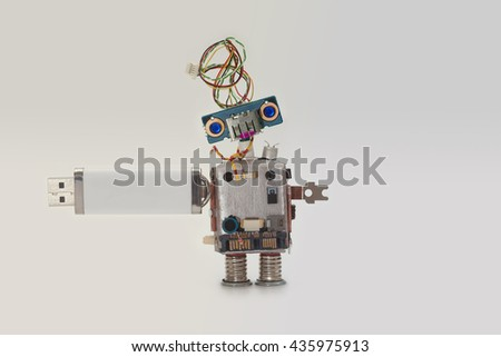 Robot with usb flash storage stick. Data storing concept, abstract computer character blue eyed head, electrical wire hairstyle. Copy space, gradient white gray background - stock photo