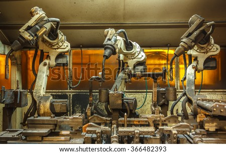 Robots welding team in the automotive parts industry - stock photo