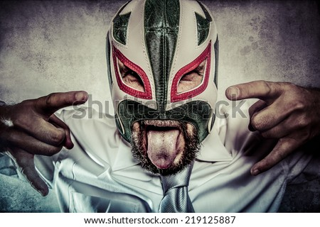 Rock and roll, aggressive executive suit and tie, Mexican wrestler mask - stock photo