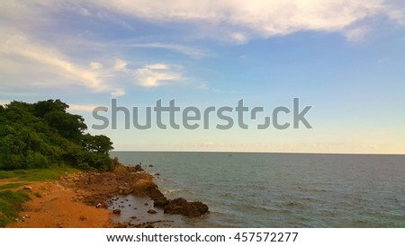 rock and sea at coastline - stock photo