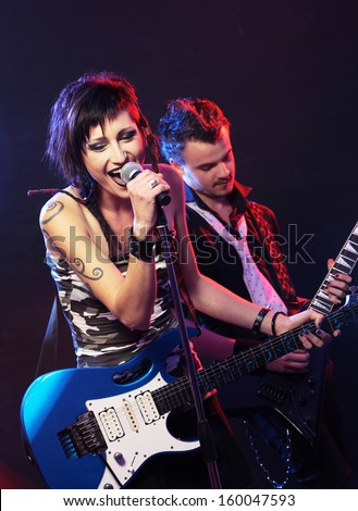 Rock band live. Band on Stage, singer and guitarist - stock photo