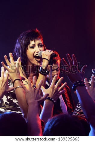 Rock band live. Singer singing for his fans - stock photo