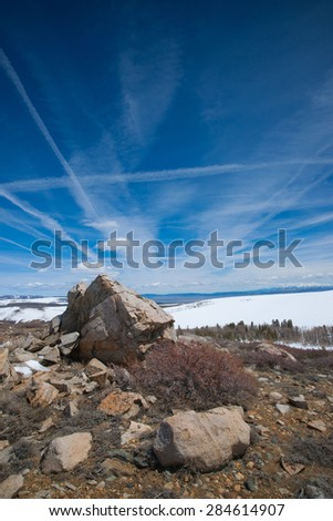 Rock boulders on the ground of mountain peak in the Sierra Nevada. - stock photo