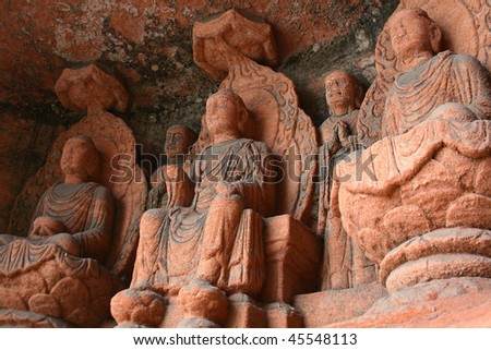 Rock carving of buddhas - stock photo