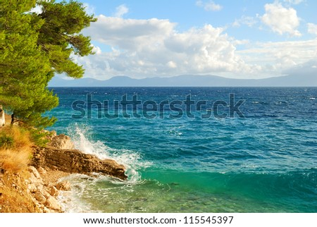 Rock Cliff Blue Sea Waves - stock photo