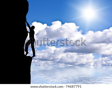 rock climber conquering a mountain on the background of sky and bright sun - stock photo