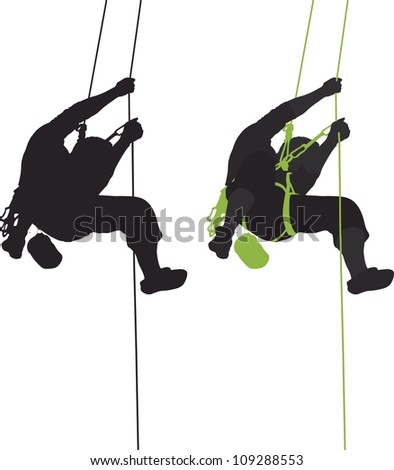 Rock climber hanging silhouette. - stock photo