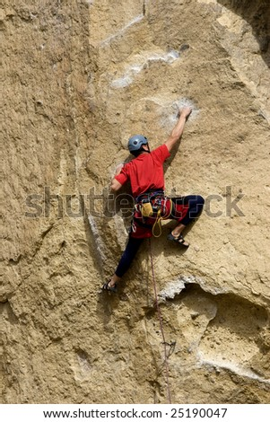 Rock climber in Central Oregon - stock photo
