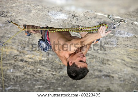 Rock climber on the cliff - stock photo