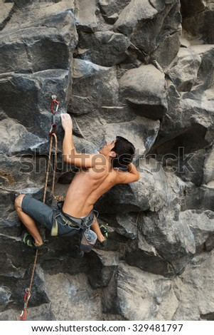 Rock Climber Shot From The Same Level - stock photo