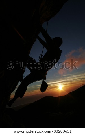 Rock climbing at Sunset - stock photo