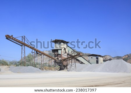 rock crusher machine industry chain moving to logistic gravel use for construction material and pollution of heavy industry  - stock photo