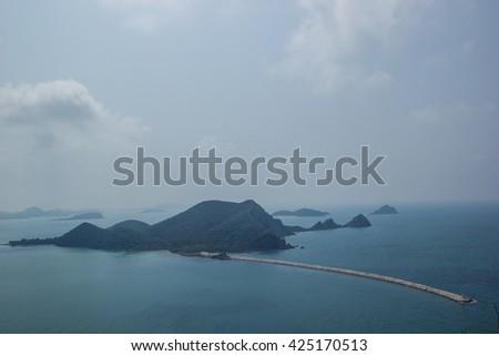 Rock dam water and waves in the Gulf of Sattahip, Chonburi. - stock photo