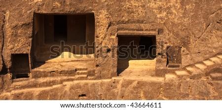 Rock Dwellings at Kanheri Caves in Sanjay Ghandi National Park, Mumbai. - stock photo
