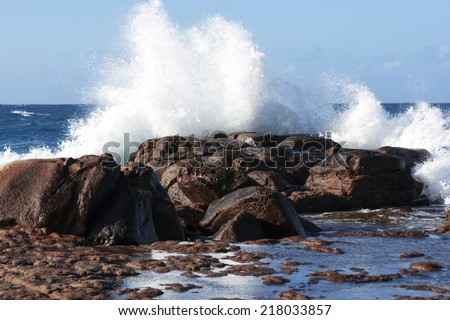 Rock face at the beach in the afternoon at Point Cartwright - Sunshine Coast - QLD. - stock photo