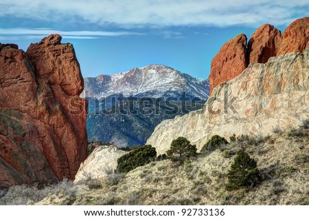 Rock formations at Colorado Springs' Garden of the Gods, with Pikes Peak in background - stock photo