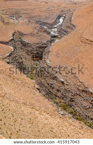 Rock formations in Atlas mountains west of Agdz near Tizi-n-Tinififft mountain pass - stock photo