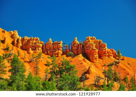 Rock formations in red canyon park in Utah near Bryce Canyon Park - stock photo