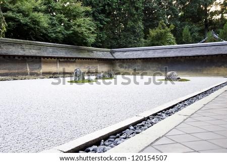 Rock garden (also called a Zen Garden) at the Ryoan-ji temple in Kyoto, Japan. - stock photo