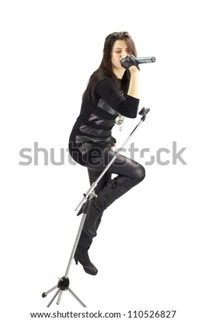 rock girl singing passionate isolated wide shot - stock photo