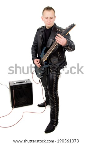 rock guitarist in the leather clothing isolated on white background - stock photo
