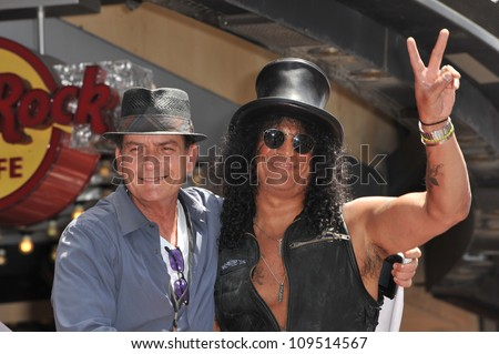 Rock guitarist Slash & actor Charlie Sheen on Hollywood Blvd where he was honored with a star on the Hollywood Walk of Fame. July 10, 2012  Los Angeles, CA Picture: Paul Smith / Featureflash - stock photo