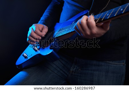 rock guitarist with blue guitar - stock photo